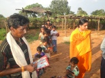 Distributing books in the school started by Sacred Association in Simariya Village
